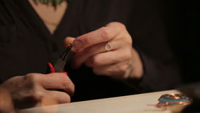 Female hand crafted jewelry stock footage