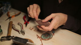 Female hand crafted jewelry stock video footage
