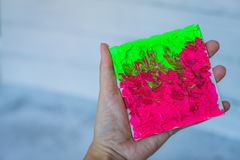 Closeup female hand with Creative art hand drawn acrylic painting. brushstrokes colorful texture acrylic paint on canvas stock image