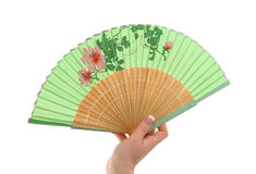 Female hand with decorated fan Stock Photo