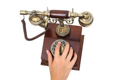 Female hand dialing old-fashioned phone Royalty Free Stock Photo