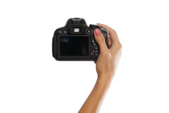 Female hand with digital camera isolated on white Royalty Free Stock Photography