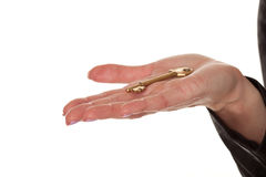 Female hand displaying a brass key Royalty Free Stock Photo