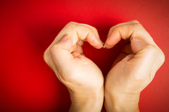 Female hand do hands heart. On valentine day stock photo