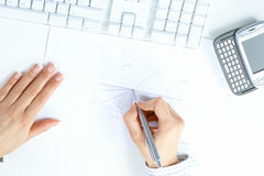 Female hand drawing chart Stock Photos
