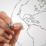 Female hand drawing earth Royalty Free Stock Image