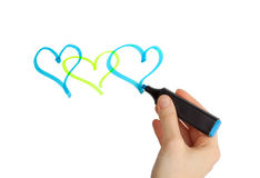 Female hand drawing hearts with blue marker on a white backgroun Royalty Free Stock Photo