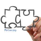 Female Hand drawing Partnership Puzzle Royalty Free Stock Image