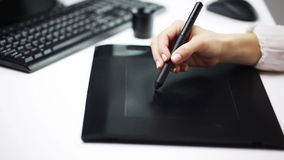 Female hand drawing with stylus on pen tablet stock footage