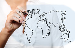 Female hand drawing a world map Stock Photos