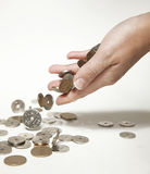 Female hand dropping norwegian coins Stock Photography