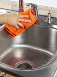 Female hand Drying Kitchen Sink Stock Image