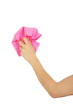 Female hand dusting pink rag Stock Image