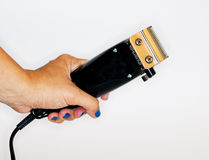 Female hand with electric razor isolated. On white Stock Photo
