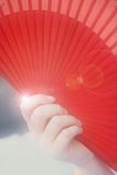 Female hand with a fan Royalty Free Stock Photo