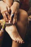Female hand and feet summer  boho jewelry Royalty Free Stock Photos