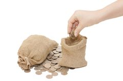 Female hand fills a bag with money Royalty Free Stock Images