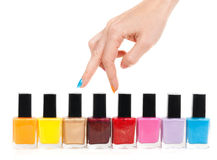 Female hand fingers are the colored paints polish Royalty Free Stock Image