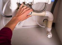 Female hand fixing plumbing Stock Images