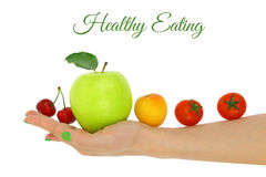 Female hand with fresh colorful fruits Royalty Free Stock Photo