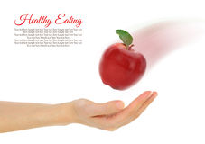 Female hand with fresh red apple Stock Images