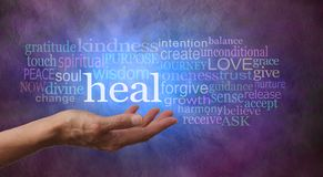 Heal Word Tag Cloud with vivid blue light. Female hand gesturing towards the word HEAL surrounded by a relevant word tag cloud on a rustic blue and purple Stock Photography