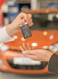 Female hand getting modern car key Royalty Free Stock Images