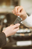 Female hand getting modern car key Royalty Free Stock Photo