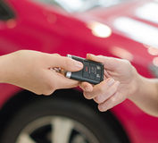 Female hand getting modern car key Royalty Free Stock Photos