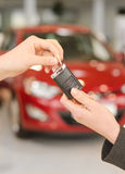 Female hand getting modern car key Stock Images