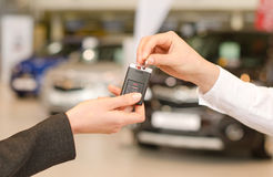 Female hand getting modern car key royalty free stock photography