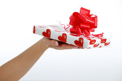 Female hand and a gift Stock Photo