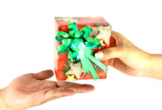 Female hand give a christmas present. With ribbon to male hand Royalty Free Stock Images