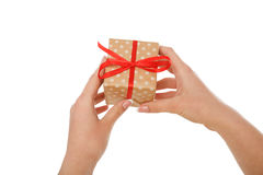 Female hand give present box, crop, cut out Stock Images