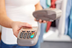 Female hand gives payment terminal Royalty Free Stock Image