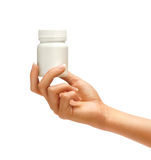 Female Hand is giving bottle for pills Stock Image