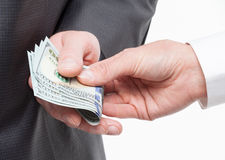 Female hand giving a bribe to businessman Royalty Free Stock Photo