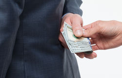 Female hand giving a bribe to businessman Stock Photo