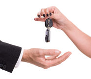 Female hand giving car key to male hand Stock Photos