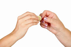 Female hand giving coin to another person Royalty Free Stock Image