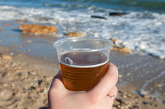 Female hand with a glass of beer Royalty Free Stock Photography