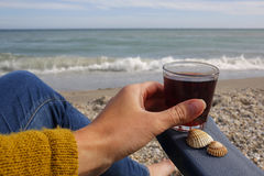 Female hand with glass of wine on the empty beach. Vacation selfie- female hand with glass of wine on the empty beach royalty free stock images