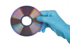 Female Hand in glove with dvd Royalty Free Stock Images