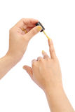 Female hand with a golden nail polish on white background Royalty Free Stock Photos