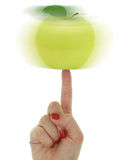 Female hand with green apple Stock Photography