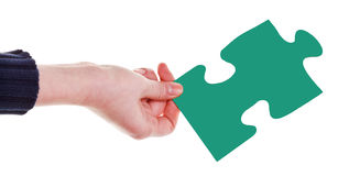 Female hand with green puzzle piece Royalty Free Stock Photos