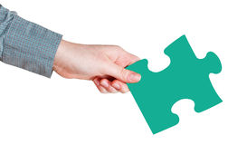 Female hand with green puzzle piece Stock Photography