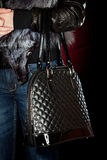 Female hand with a handbag Royalty Free Stock Photos