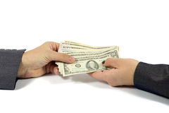 Female Hand Handing Cash To Male Hand Against White Background Stock Images