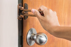 Female hand on handle, opening or closing door Stock Photo